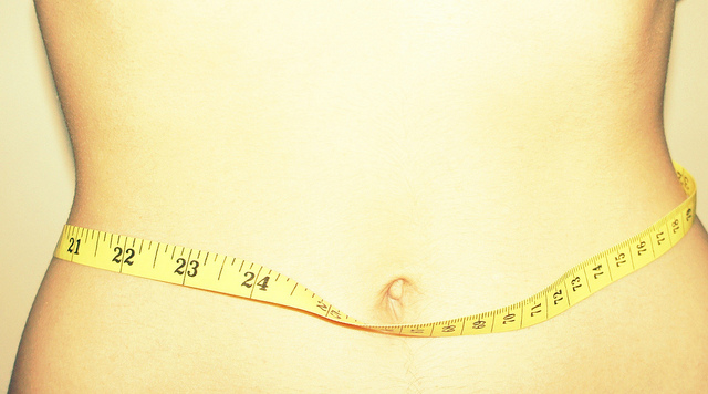 woman's hips with measuring tape - weight loss